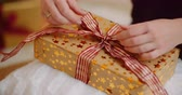 boxy : Midsection Of Woman Tying Ribbon On Christmas Present