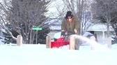 clareira : Man Snowblowing The Sidewalk Man using snowblower to clear deep snow on sidewalk after heavy snowfall.