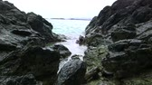 зрелище : Tide Slooshing with Great Sound Effects A rush of water between the rocky shore simply keep on pushing.