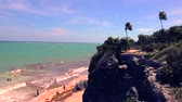 establishing shot : A windy day in the hot Mexico heat overlooking a beach with the cliff nearby. Stock Footage