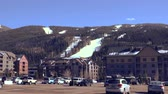 establishing shot : Parking Lot of Ski Resort. Looking at a ski resort from the parking lot. Stock Footage