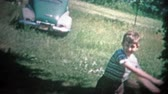 сбор винограда : ALBANY, NY. USA - 1953: City kids visiting the farm and playing baseball with whatever they had. Original vintage 8mm home movie film professionally cleaned and captured in 4k 3840x2160 UHD resolution plus post processing including cinematic retro color c