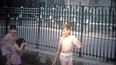 à beira da piscina : NEW YORK CITY - 1953: Kids playing at a New York City public swimming pool. Original vintage 8mm home movie film professionally cleaned and captured in 4k 3840x2160 UHD resolution plus post processing including cinematic retro color correction, deflickeri