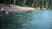 szemcsés : 8mm Vintage 1968 Women Catching Fish with Long Pole