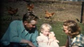 iowa : 8mm Vintage 1952 Dad Mom  Baby Farm Picnic, Chickens In Background. Iowa, USA. Stock Footage