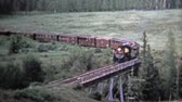 szemcsés : CHAMA, NM. USA -1972: Train cross a bridge and pov from inside coal powered engine. Unique vintage 8mm film home movie professionally cleaned and captured in 4k 3840x2160 UHD resolution plus post processing including cinematic retro color correction, manu
