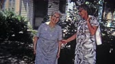 NEW ORLEANS, LA -1971: Old women childhood friends sharing embrace and laughter.