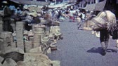 MEXICO CITY -1974: Marketplace of live chickens, baskets, caged exotic parakeet bird.