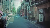 idegen : TOKYO, JAPAN -1972: Japanese wooden tourist items and city street.