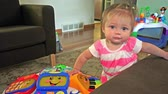 smiling girl : Closeup cute baby standing and smiling living room. Stock Footage