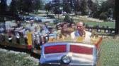 priceless : DENVER, COLORADO 1951: Family riding Elitch Gardens classic train ride Stock Footage