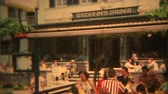 FRANKFURT, GERMANY 1973: German beer garden with people sitting outside in summer. Стоковые видеозаписи