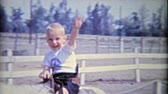 priceless : 1962: Boys riding horses for 1st time smile and wave hello.