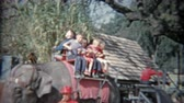 1963: Kids riding on Asian elephant at amusement park ride for privileged children.