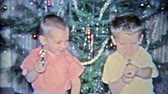 1964: Kids pulling toy guns in front of Christmas tree as you do.