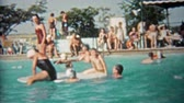 pamięć : 1959: People of all ages playing in public pool during a hot summer day.