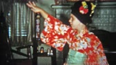 1957: Girl dancing indoor geisha outfit on japanese style body movements.