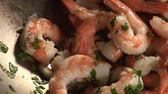 deep sea shrimps : Prawns with garlic, chilli and herbs in a wok Stock Footage
