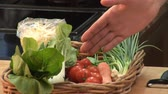 green onion : Hand showing basket of vegetables Stock Footage