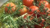 rosmarinus : Frying tomatoes, garlic and herbs in oil Stock Footage