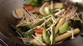 meat free : Mixing sprouts with vegetables in a wok