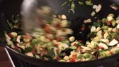 asiatic cooking : Stir-frying vegetables in a wok
