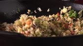 asiatic cooking : Cooking vegetable rice in a wok Stock Footage