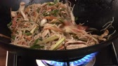 noodle dish : Chicken, vegetables and noodles in a wok Stock Footage