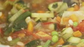 stirred : Minestrone being stirred