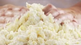 misturando : Cooked potatoes being mixed with flour and egg Stock Footage