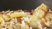 potatoe recipe : Fried potatoes being seasoned with salt and pepper Stock Footage