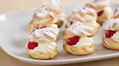 молочный продукт : Profiteroles filled with cream and raspberries