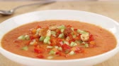 aperitivo : Croutons being sprinkled onto gazpacho Stock Footage