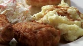 meat dish : Deep-fried chicken pieces with coleslaw and potato salad