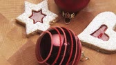 trimmings : Rotating jam biscuits and Christmas baubles Stock Footage