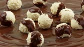 chocolate sauces : White chocolate truffles on melted milk chocolate