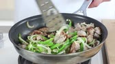green onion : Sausage meat, onions and peppers being fried