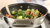 meat free : Vegetable couscous being sprinkled with parsley