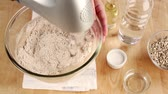 słonecznik : Ingredients for bread dough being kneaded with a food processor