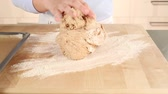 forming : Bread dough being shaped into a loaf on a floured work surface Stock Footage