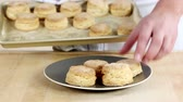 специальность : Freshly baked buttermilk biscuits being placed on a plate