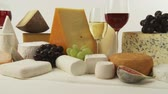 different cheeses : Various cheeses with wine and grapes