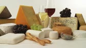 direito : Various cheeses with wine, grapes and savoury biscuits