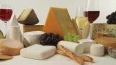 different cheeses : Various cheeses with wine, grapes and savoury biscuits