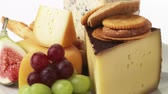 different cheeses : Various cheeses with savoury biscuits and grapes