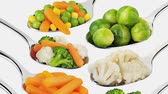 steamed : Various vegetables on spoons and forks