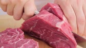 slices : Cutting a shoulder of beef into thick slices Stock Footage