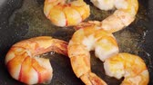 deep sea shrimps : Frying prawns in a pan and scattering them with salt