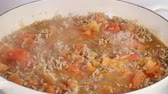 meat dish : Adding stock to pan of minced meat Stock Footage