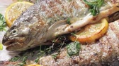 slices : Grilled trout with lemon and herbs